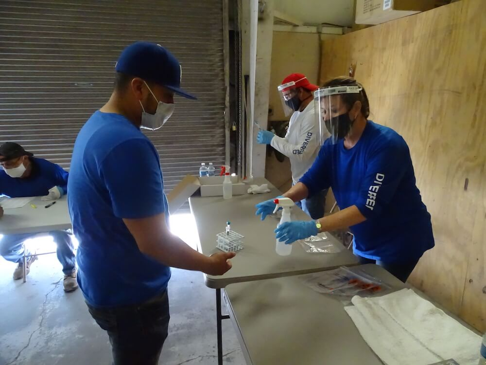 Diversified Interiors employees wearing protective gear, sanitizing hands